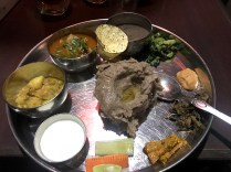 A typical Thakali community thali of Nepal consisting of lentil, pickle, curd, meat, millet, salad, veggies and papad; Photo: Abhinav Kaushal