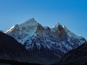 'Mystical Uttarakhand Bhagirathi Peaks' by Abhishek Kaushal shows the early morning sun rising over the Bhagirathi Peaks I, II, and III.