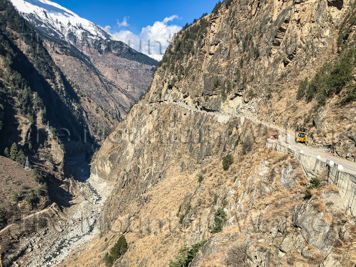 "'Baspa Sangla Karcham Ledge' by Sanjay Mukherjee shows ""The Ledge"" section of the Sangla to Karcham Road cut into the rock face above the Baspa River."