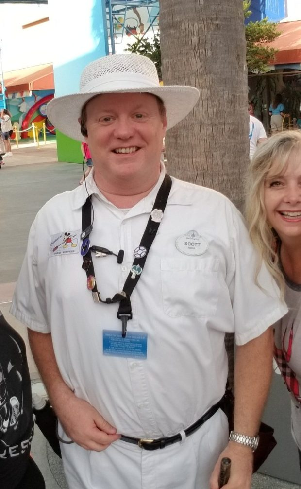 Disney cast member with mystery trading pin