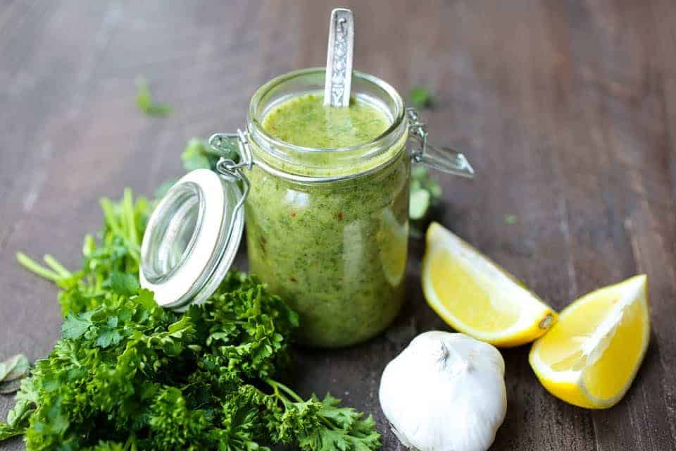 This Chimichurri Sauce is a fresh and vibrant combination of herbs and spices, resulting in an easy-to-make sauce & marinade! TheMovementMenu.com