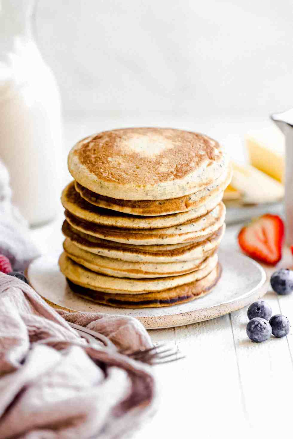 a stack of keto coconut flour pancakes on a plate