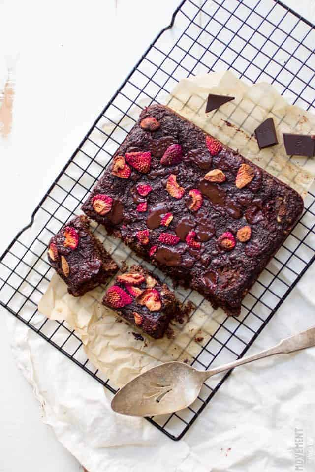 These chocolate banana strawberry bread squares are definitely a mouthful, but they also taste incredible in your mouth. Making them is so easy and they taste perfect with a glass of your favorite non-dairy milk! Gluten free + paleo, too!
