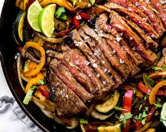 steak fajitas in a cast iron pan