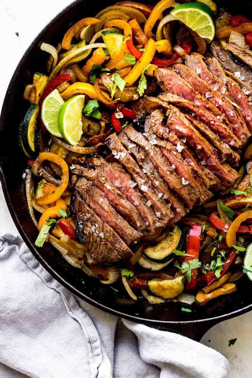 steak fajitas in a cast iron pan