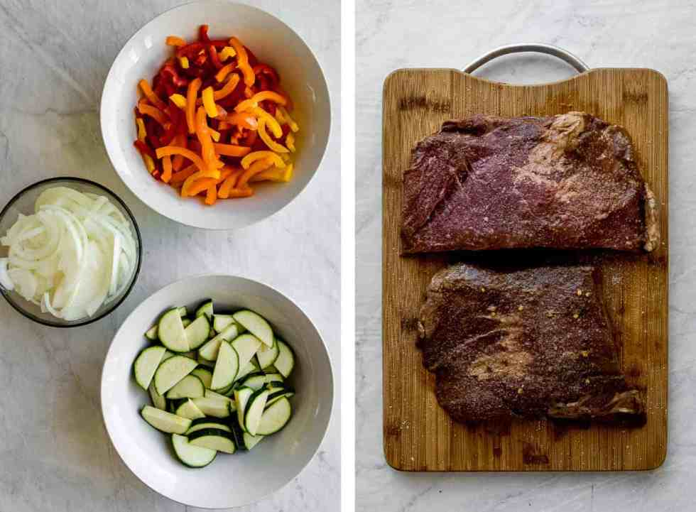 vegetables prepped in bowls and steak marinating on a cutting board