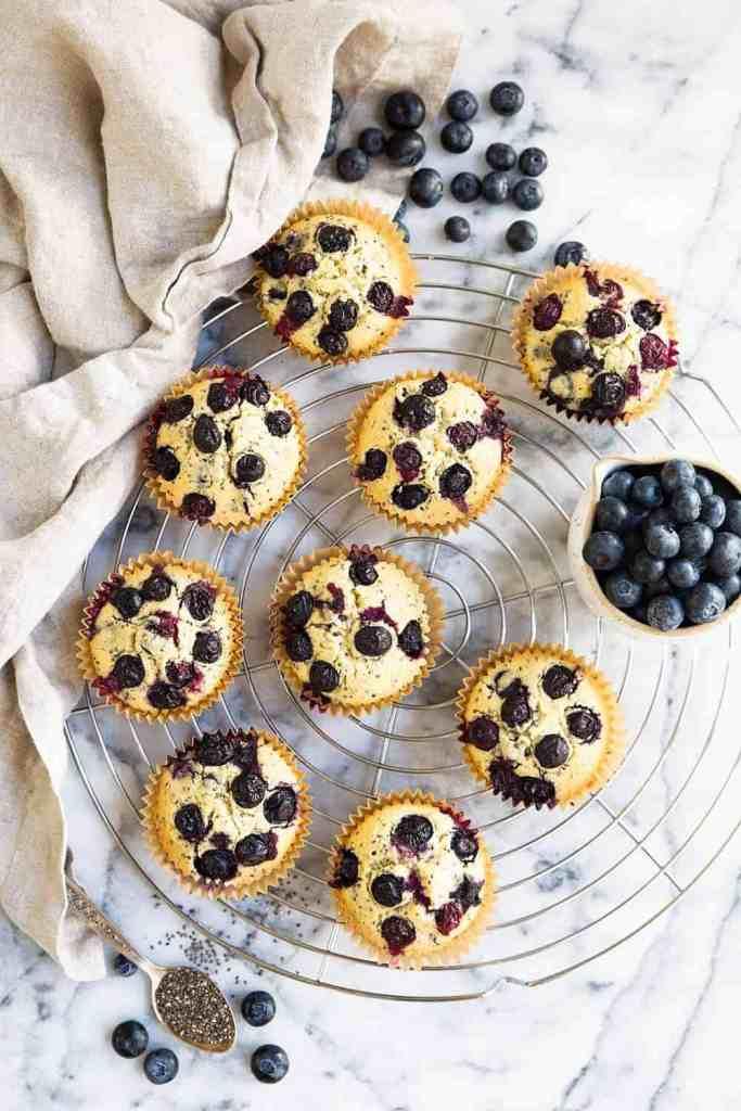 overhead shot of gluten free vegan blueberry muffins on a circular wire rack