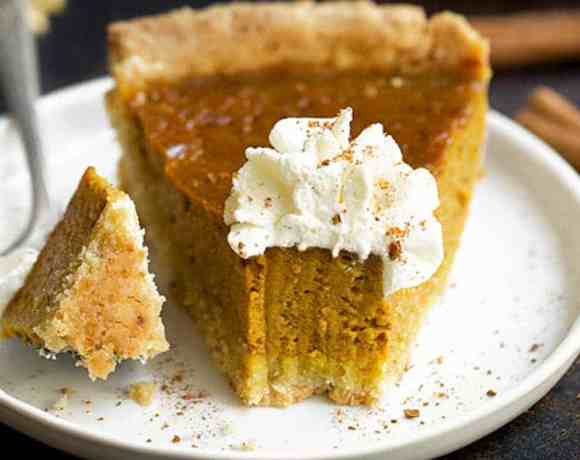 A Gluten Free Vegan Pumpkin Pie recipe with an incredibly flaky crust and the most delicious and comforting pumpkin filling ever. This pumpkin pie is gluten free, vegan and paleo friendly as well. Gluten free pumpkin pie. Paleo pumpkin pie recipe. Vegan pumpkin pie. Paleo pumpkin desserts. Vegan pumpkin desserts.