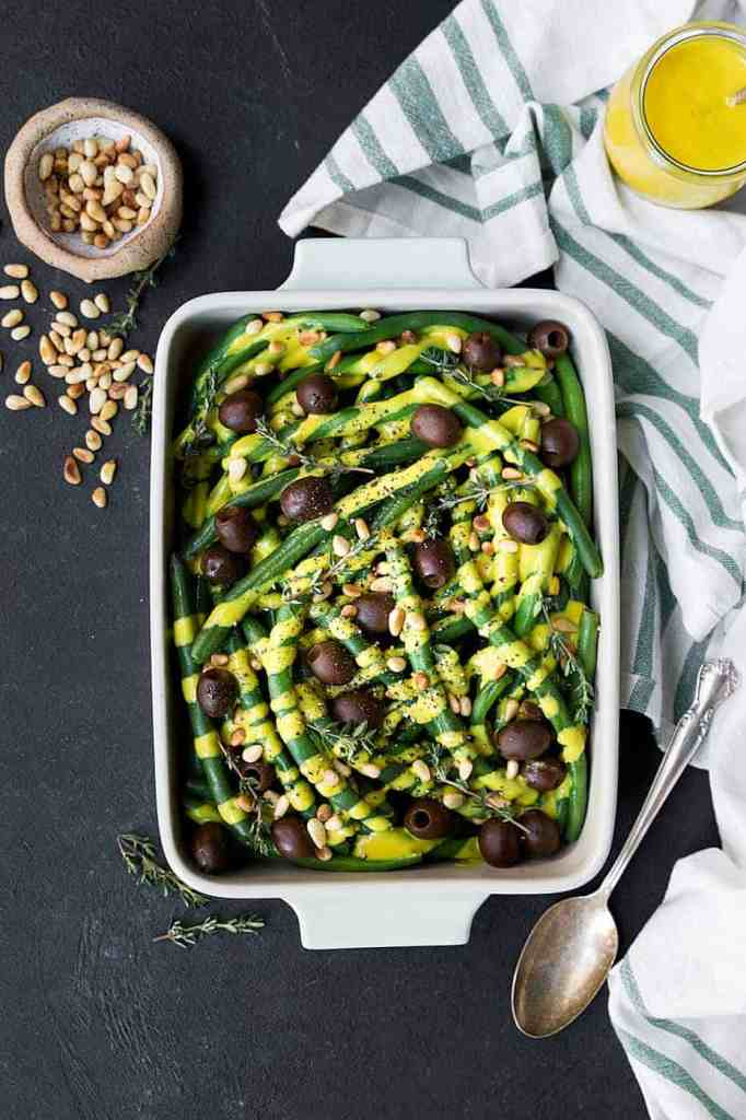 Paleo Green Beans. A perfect side dish for your Thanskgiving table or really any time of the year are these green beans with dairy free pumpkin alfredo and olives. Paleo thanksgiving recipes.