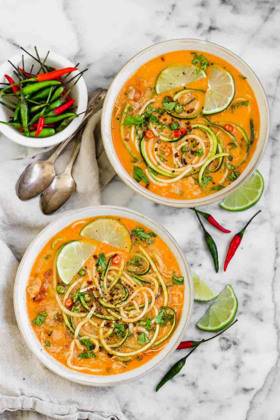 two bowls of chicken zucchini noodle soup