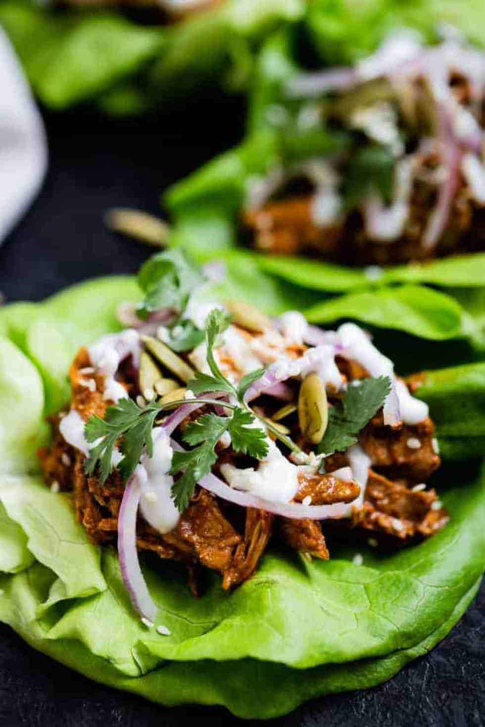 close up of chicken mole tacos wrapped in lettuce