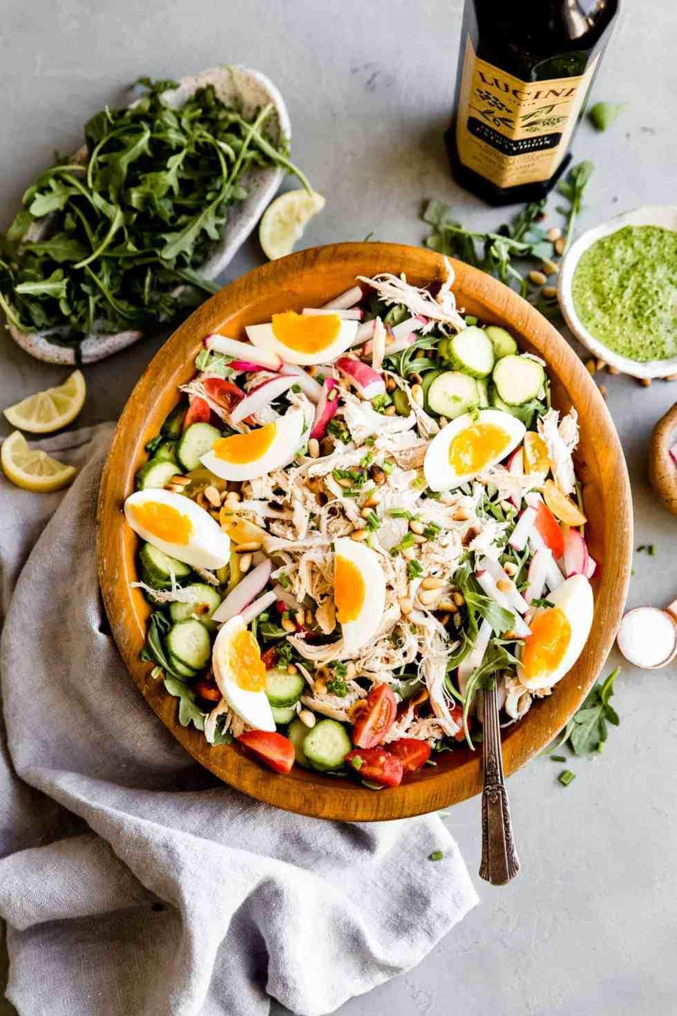 overhead shot of paleo pesto chicken salad in a big bowl