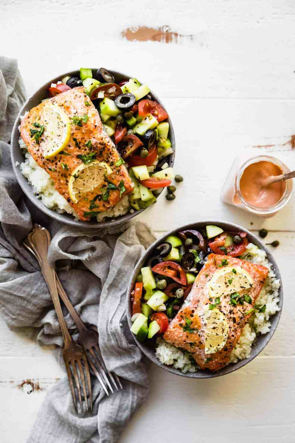 overhead shot of two bowls of whole30 greek salmon