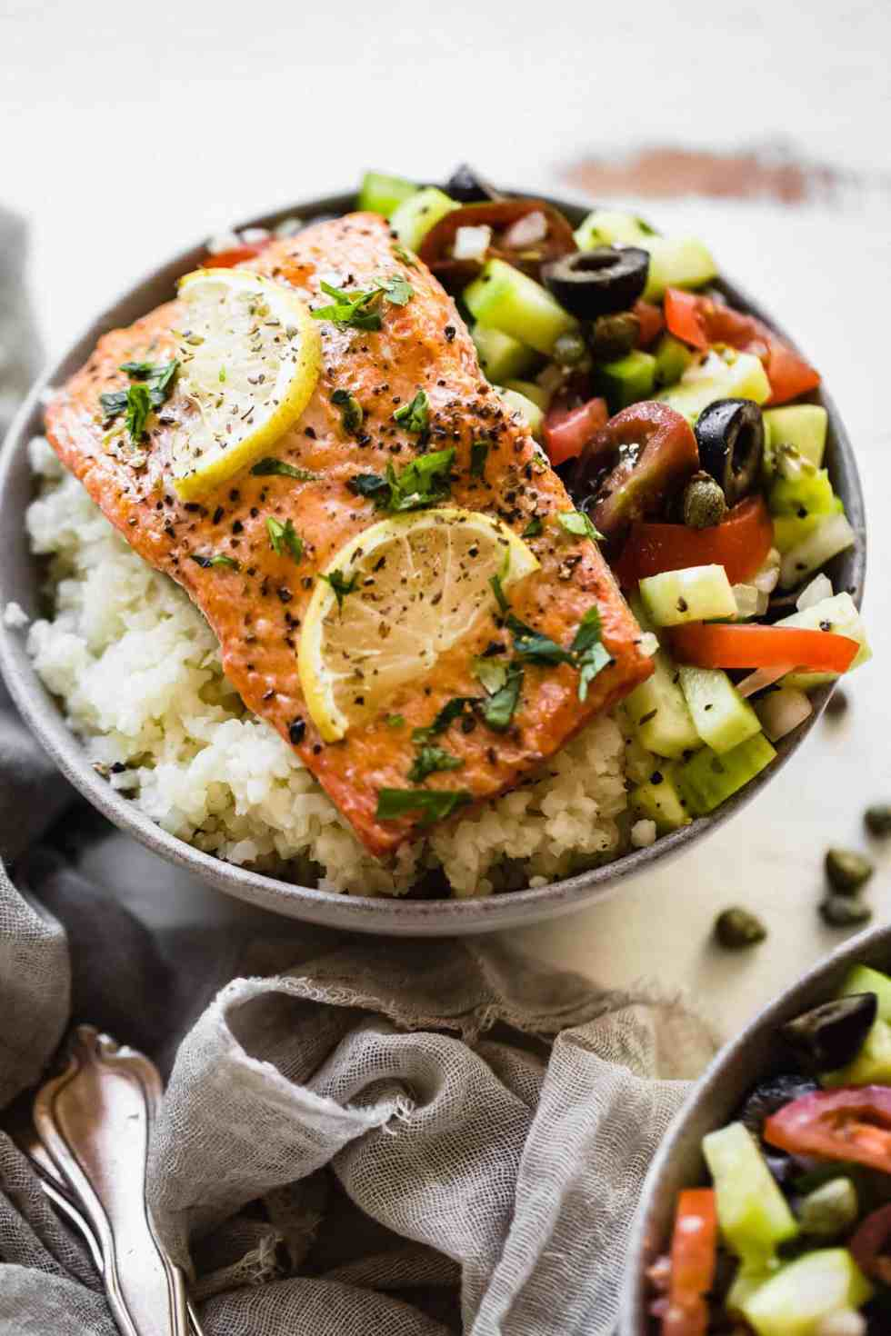 close up of Whole30 Greek salmon in a bowl with cauliflower rice and salad