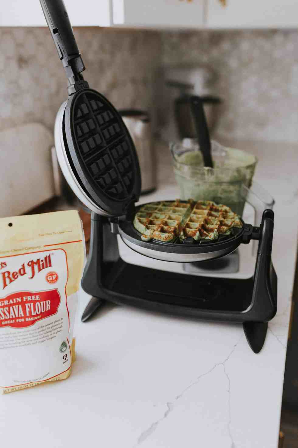 waffles cooking on the counter in a waffle iron