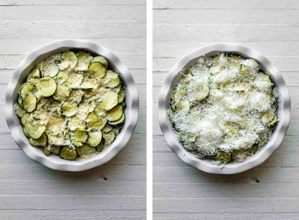 zucchini rounds in a white quiche pan with parmesan cheese on top