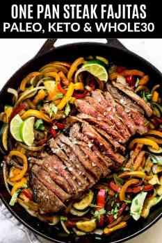 steak fajitas in a cast iron pan with flaked salt on top