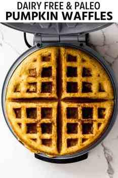 pumpkin waffles being made inside of a waffle iron