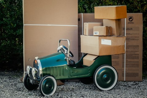 moving boxes and a car