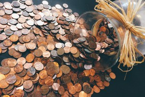 A jar with coins spilling out