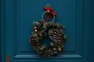 Pinecone wreath on door for Christmas for moving during holidays