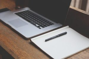 Laptop, notebook and pen that you'll need to use to plan everything and thus reduce stress when moving.
