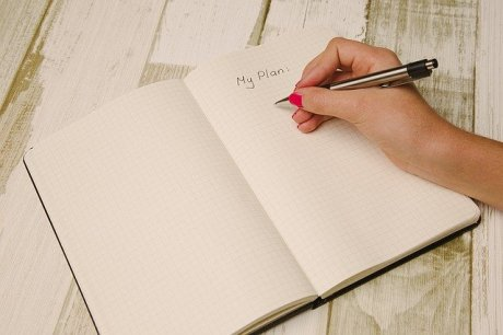 A woman getting ready to write down her plan regarding moving from New York to LA.