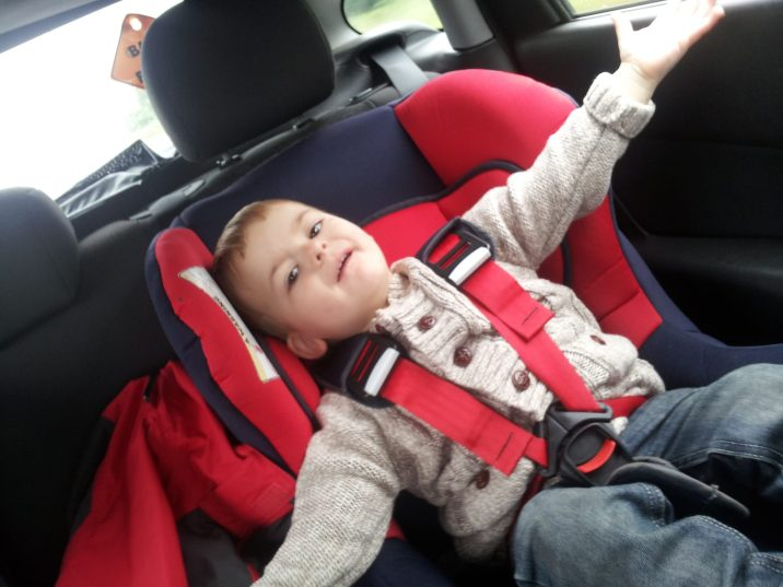 Child sitting in car seat