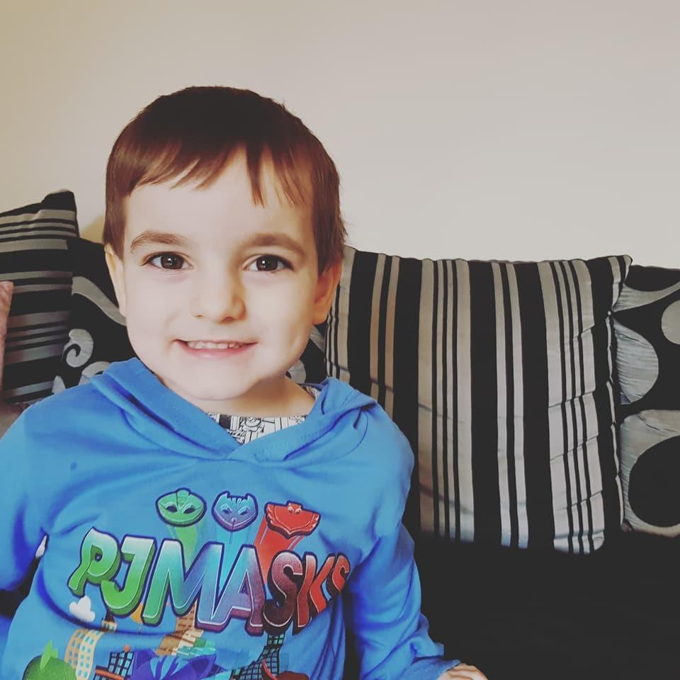 Small boy wearing Pj Masks top