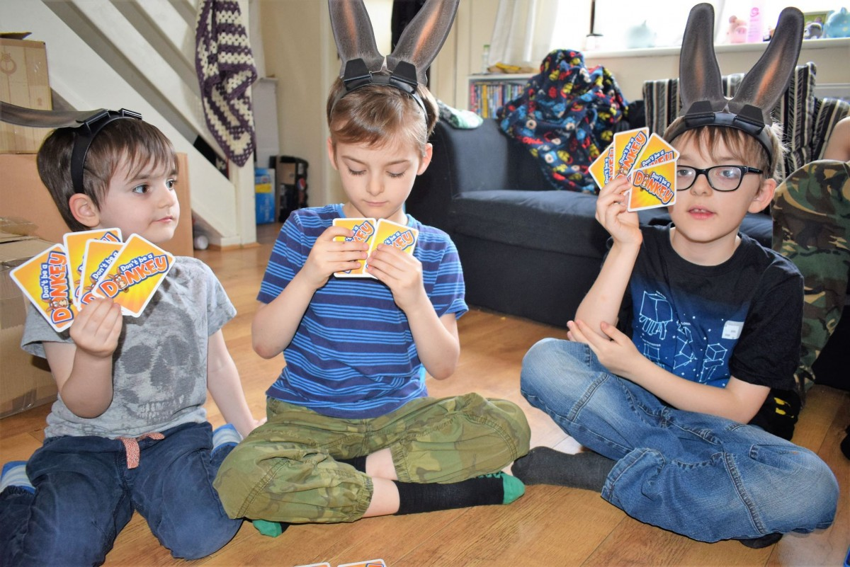 3 children playing Don't be a Donkey