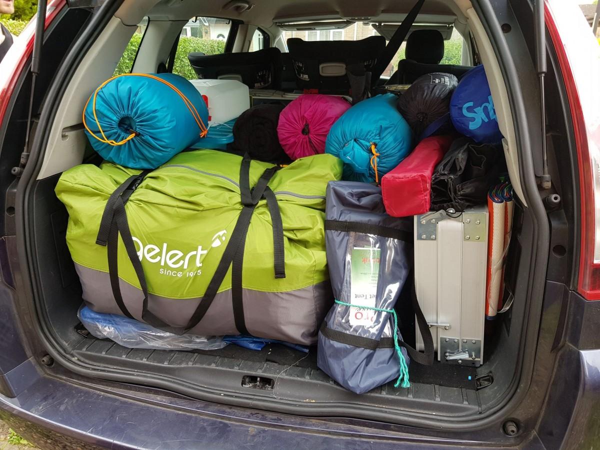 Car boot full of camping gear