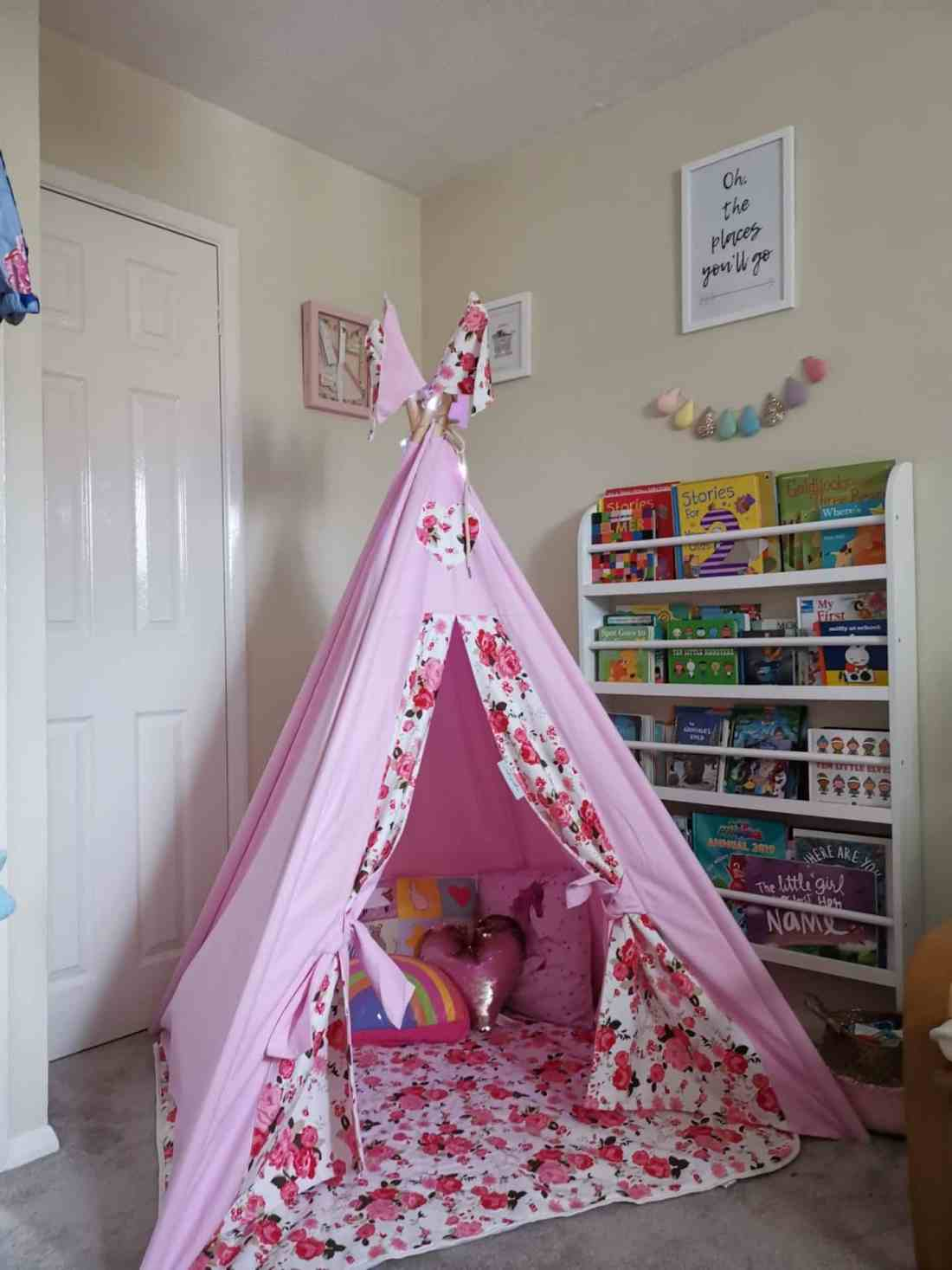 Toddler den in a playroom with bookcase