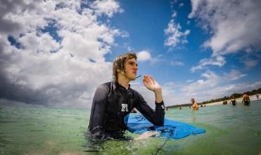 He surfs.