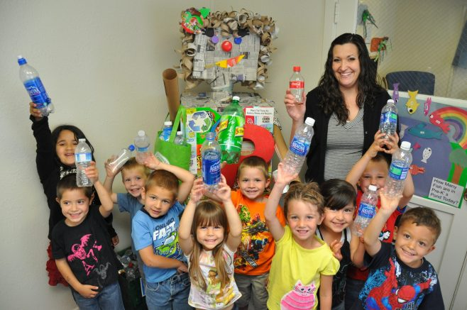 class learning about the importance of recycling and being enviornmentally friendly