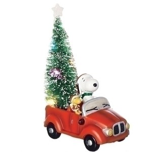 Snoopy and Woodstock in red car with Christmas Tree