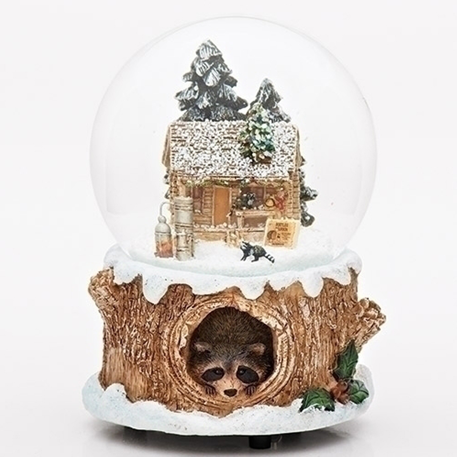 Musical snow globe with a cabin and raccoon inside, base is a tree with a raccoon looking out