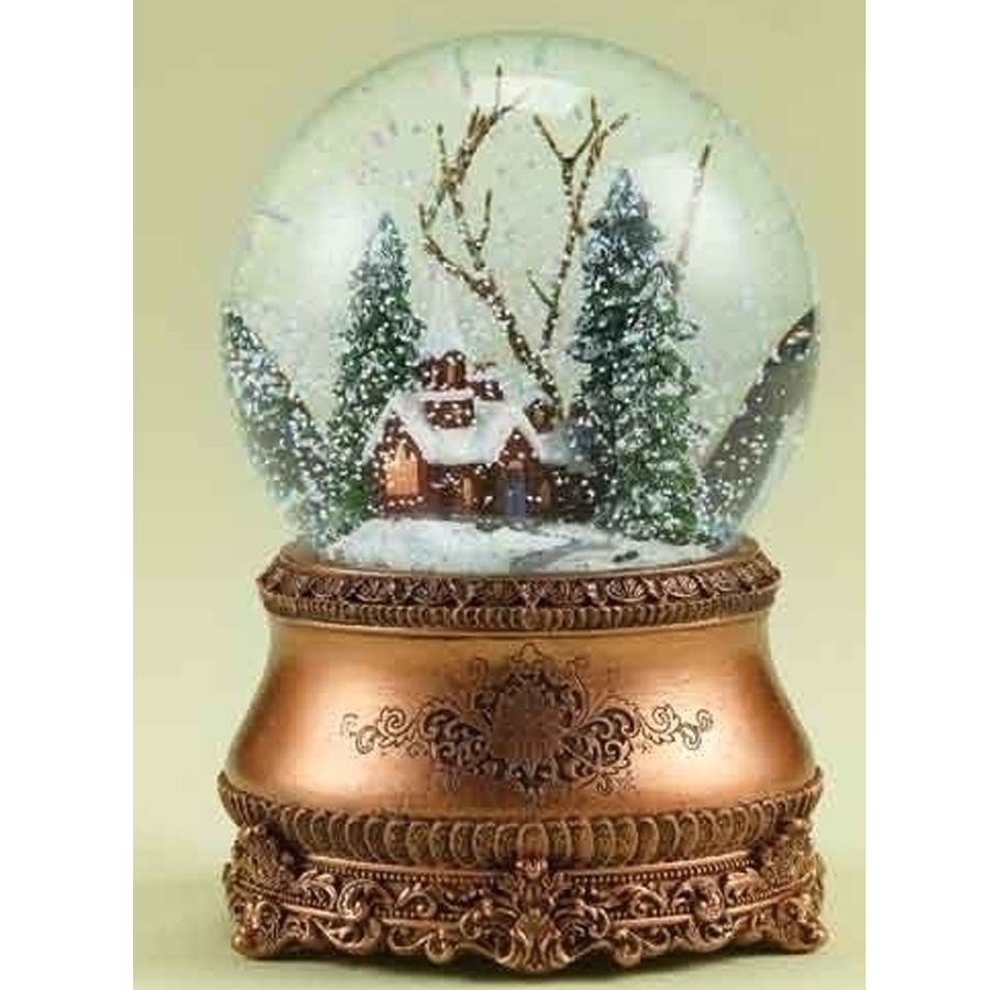 Church in a snow globe set in a pine tree setting with musical gold base