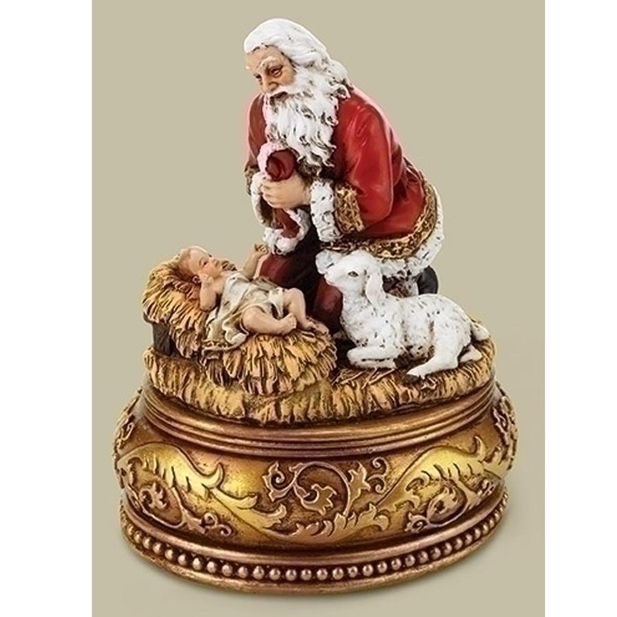 Santa kneeling by manger with gold base