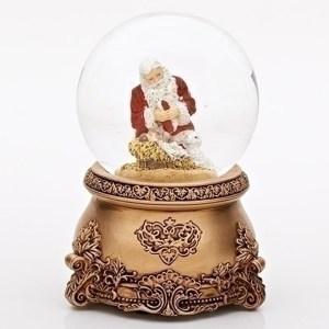 Santa kneeling by manger musical globe with gold base