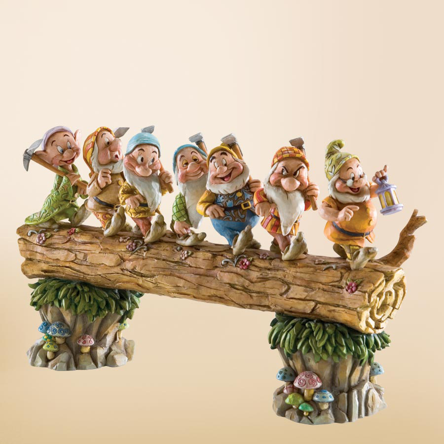 Seven Dwarfs on log Jim Shore