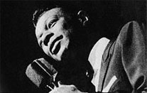 Nat King Cole at the mike