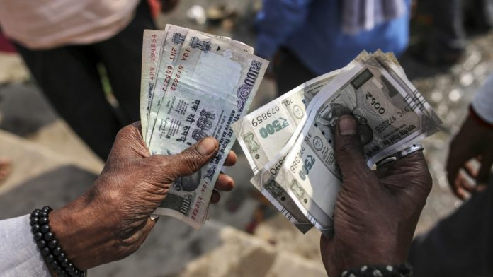 Rupee falls to 75 for first time, stocks continue to drop as foreigners pull out $10 bn