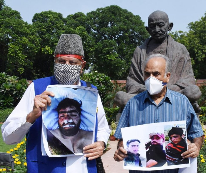 """In parliament, NC leaders protest against """"fake encounters and custodial killings"""""""