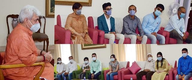 Lt Governor meets J&K NEET topper Avikshit Gupta, 4 others