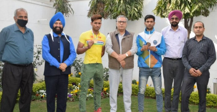Advisor Farooq Khan interacts with medalists of 20 KM Mass-Start Cycling competition