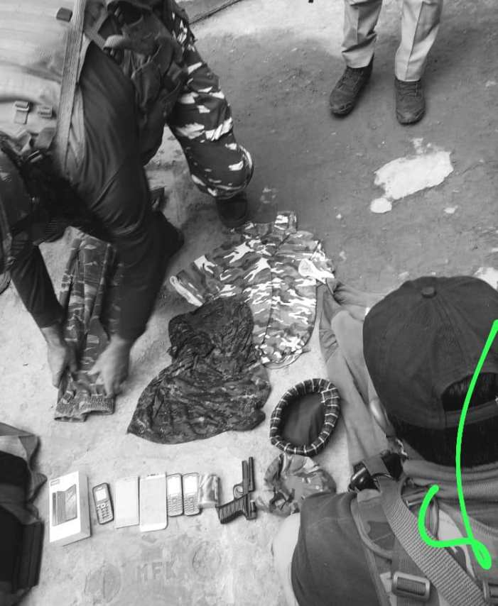 Police recover military uniforms and cell phones during a raid