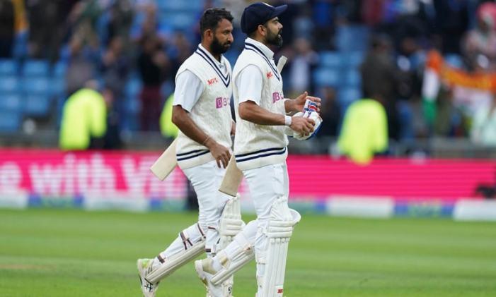 Pujara, Kohli hold firm to keep England at bay