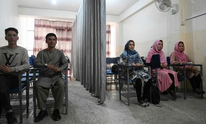A curtain divides male, female students as Afghan universities reopen