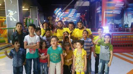 Volunteers with Fundraising Manager Khoyrul Shaheed from HRF in Jordan taking Orphans to purchase Eid Gifts.