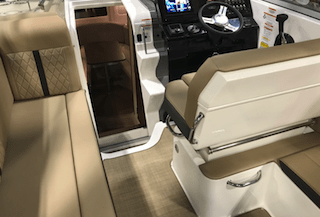 boat cabin with carpet and helm to show cleaner